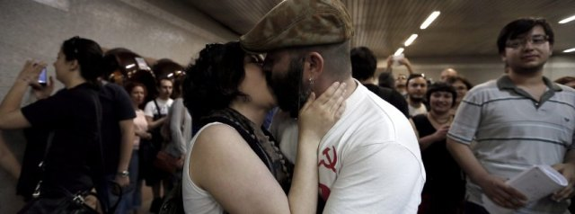 Turkish demonstrators kiss each other to protest moral warnings a
