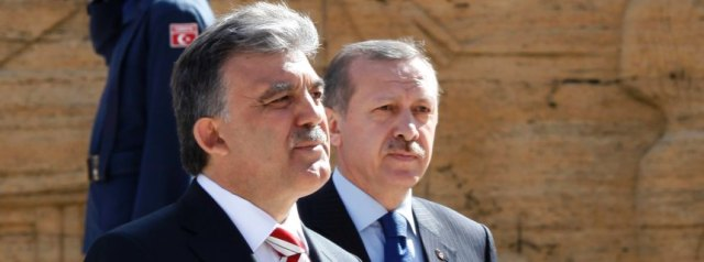 Turkish President Gul and PM Erdogan leave a wreath-laying ceremony at the mausoleum of Ataturk in Ankara