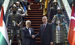 Recep Tayyip Erdo?an, right, shakes hands with his Palestinian counterpart Mahmoud Abbas