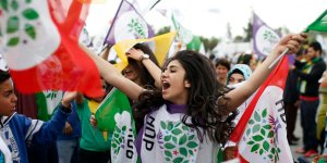 Supporters cheer Selahattin Demirtas, co-chair of the pro-Kurdish Peoples' Democratic Party, HDP, as he addresses an election rally in Istanbul, Turkey, Saturday, May 30, 2015. Turkey will hold general election on June 7, 2015 and approximately 56 million Turkish voters are eligible to cast their ballots to elect the 550 members of the Grand National Assembly.(AP Photo/Emrah Gurel)
