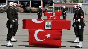 Turkish-honour-guards-stand-next-to-the-flag-draped-coffin-of-Lt-Col-Ilker-Cel
